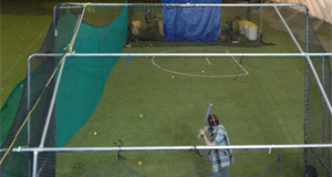 Person Practicing in Baseball Batting Cage
