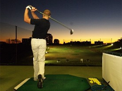 golf driving range outdoor teeing off at night